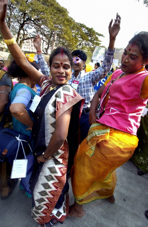 Two Indian Hijras, or transexuals, dance