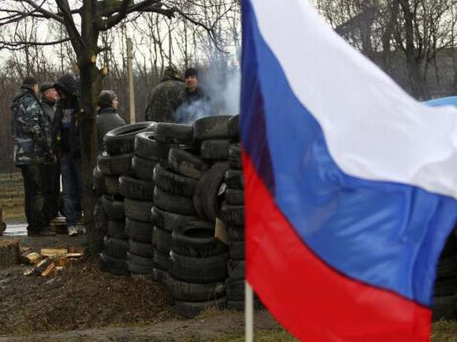 Members of a pro-Russian self-defence unit gather at a check point in Gorlovka in Donetsk region