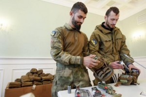 Medical volunteers unpack individual first aid kits similar to those used by NATO during a ceremony where they were donated by Kiev's Mayor Vitaly Klitschko in Kiev