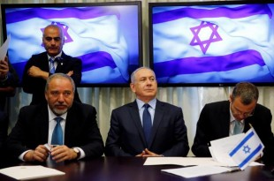 Avigdor Lieberman, head of far-right Yisrael Beitenu party, sits next to Israeli Prime Minister Benjamin Netanyahu as they sign a coalition deal to broaden the government's parliamentary majority, at the Knesset, the Israeli parliament in Jerusalem