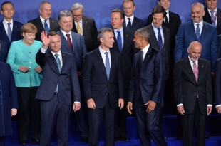 Family photo of Allied and Partner Heads of State and Government and Head of International Organizations - NATO Summit Warsaw