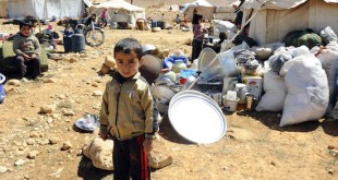 A Syrian refugee child who fled the violence from the Syrian town of Flita, near Yabroud, poses for a photograph at the border town of Arsal