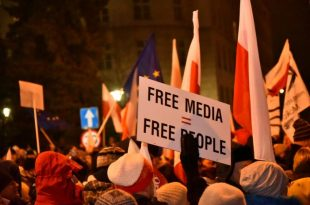 People demonstrate against new restrictions for media at the Polish Parliament in front of the Parliament building in Warsaw,